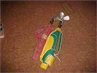 Two Sets of Small Golf Clubs
