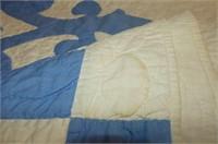 Blue-on-White Applique Quilt