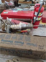 roll of plastic, oil filters, grease gun, fire