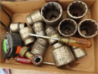 three quarter inch sockets, tape measure, saw,