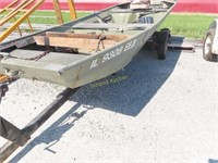 fishing boat on trailer with flat tire and  motor