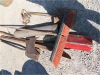 rope, broom, shovels, post hole digger, fuel tank