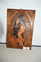 Carved, hand decorated