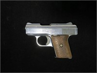 Raven Arms Model MP-25 nickel/walnut .25 Auto,