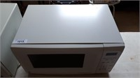Ge Microwave 21 Inches Long By 14 And 1/2 In Wide
