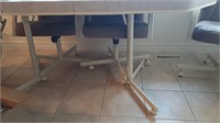 Table And 4 Chairs On Casters. No Contents On