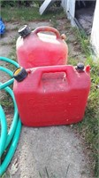 Garden Hose And 2 Gas Cans