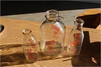 3 glass milk bottles