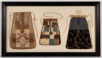 An excellent collection of early 19th-century sewing pockets, framed together, Vogel Collection