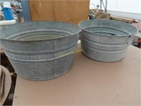 two antique galvanized tubs with handles