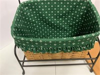 Newspaper basket with wrought iron stand.
