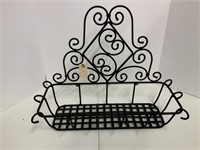 Wrought iron wall plant holder.