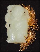 14 K Gold and Jade.