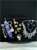 Assorted costume jewelry and pins