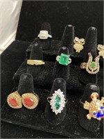 13 assorted rings and one pair of earrings