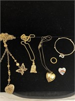 Necklaces, bracelet, ring, and money clip lot
