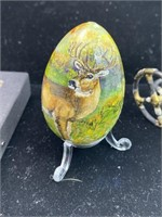 Decorative egg, bike and necklace lot