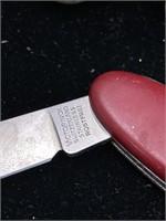 Antique bullets and victorinox pocket knife