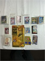 Assorted sports cards and football game