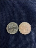 Two arcade play tokens