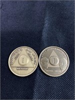 Two unity service recovery coins