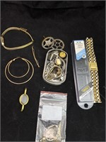 Assorted watch pieces and jewelry