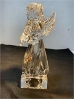 Wood pipe sculpture and glass angel sculpture