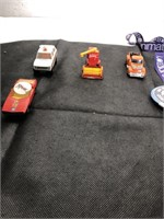 Set of toy cars, a piggy bank and a lanyard