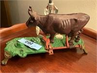 CAST IRON MILKING COW BANK PART