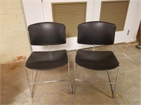 (51) Stackable Black Chairs $15.00 Reserve