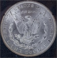 Coin 1884-CC Morgan Silver Dollar in ANACS MS62