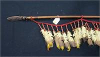 Abenaki Indian spear with turkey feathers,