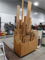 Wooden storage rack on wheels with lumber