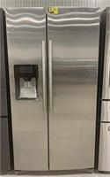 Samsung side by side refrigerator/freezer.