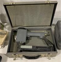 Senco staple gun in metal case