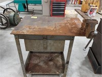Metal work bench on wheels with vise