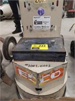 EDCO single-disc concrete floor grinder.