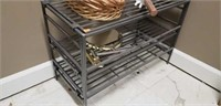 Metal shoe rack with shapoo, a vase, ect
