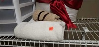 Estate lot of a pillow, towel, container.