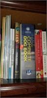 Estate shelf of books, paper, and a box