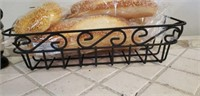 Metal basket with faux bread & waiter decor