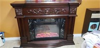Beautiful electric fireplace with wooden mantel
