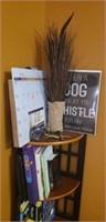 Corner shelf with books ect on it