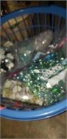 Basket full of beads, marbles, ect