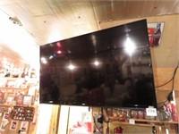 """60"""" RCA TV & Soundbar."""
