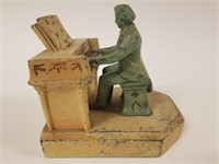 Cast iron pianist and piano