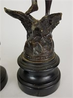 Pair of cast statues