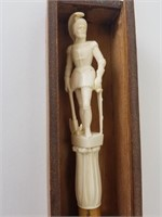 Cane with hand carved handle and tip