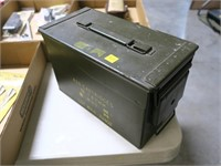 OD green ammo can with misc loose ammo and