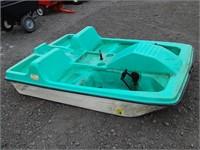 Pelican plastic paddle boat.